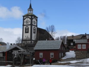 The Røros Church steeple among some of the old homes.